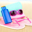 Beach accessories on mat — Stock Photo