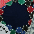 Frame made of poker chips, playing cards and dollars on the blue background — Stock Photo