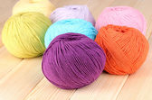 Knitting yarn on wooden background — Stok fotoğraf