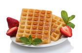 Belgium waffles with honey, strawberries and mint on plate isolated on white — Stock Photo