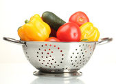 Fresh vegetables in silver colander isolated on white — Stock Photo