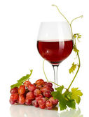 Glass of wine and ripe grapes isolated on white — Stock Photo