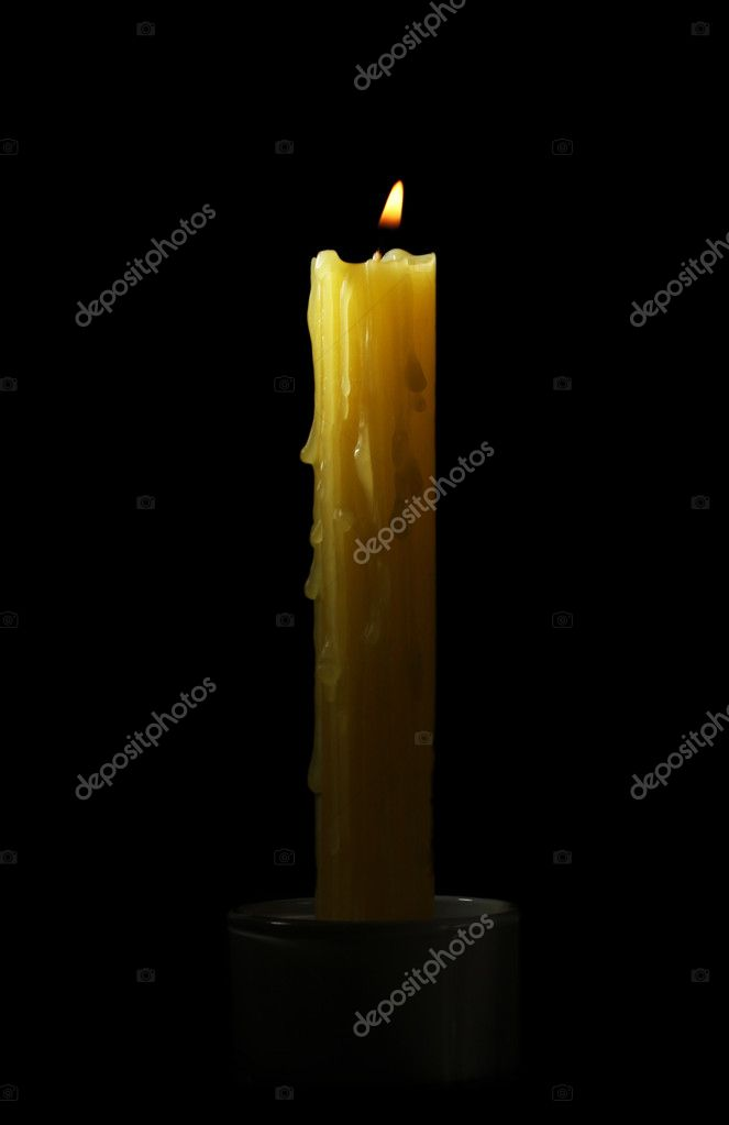 Yellow candle on black background — Stock Photo #11352247