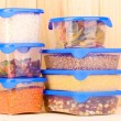 Royalty-Free Stock Photo: Filled plastic containers on wooden background