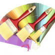 Paint brushes and bright palette of colors isolated on white - Foto Stock