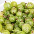 Green gooseberry in glass bowl close-up — Stock Photo