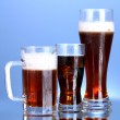 Refreshments - beer, cola and kvass on blue background — Stock Photo