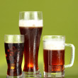 Refreshments - beer, cola and kvass on green background — Stock Photo