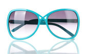 Fashionable women's blue sunglasses isolated on white — Stock Photo