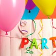 Stock Photo: Party. Balloons on white wooden background close-up