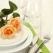 Beautiful holiday table setting with flowers — Stock Photo