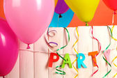 Party. Balloons on white wooden background close-up — Stock Photo