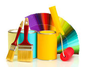 Tin cans with paint, roller, brushes and bright palette of colors isolated on white — Stockfoto