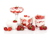 Glasses of ripe strawberries with cream isolated on white — Stock Photo