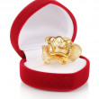 Gold ring with golden flower and clear crystals in red velvet box isolated on white — Stock Photo #11418607