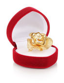 Gold ring with golden flower and clear crystals in red velvet box isolated on white — Stockfoto