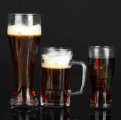 Refreshments - beer, cola and kvass isolated on black — Stock Photo
