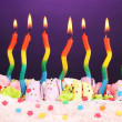 Birthday cake with candles on violet background — Stock Photo