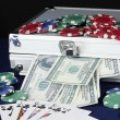 Suitcase with dollars on the blue poker table close-up — Stock Photo