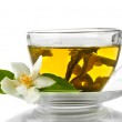 Cup of green tea with jasmine flowers isolated on white — Stock Photo
