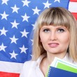 Young woman on the background of the flag of America — Stock Photo #11436311
