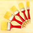 Paint brushes on wooden background - Photo