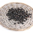 Black currant on wicker mat isolated on white — Stock Photo #11436917