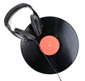 Black vinyl record and headphones isolated on white — Stock Photo