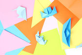 Blue origami on bright paper background — Stock Photo