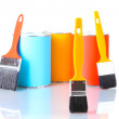 Cans of paint with paintbrushes isolated on white close-up — Stock Photo