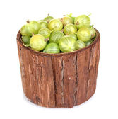 Green gooseberry in wooden cup isolated on white — Stock Photo