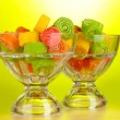 Colorful jelly candies in in glass bowls on green background — Stock Photo #11467462
