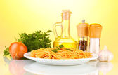 Composition of the delicious spaghetti with tomato sauce on bright background — Stock Photo