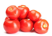 Ripe red tomatoes isolated on white — Stock Photo