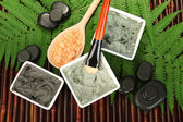 Cosmetic clay for spa treatments on bamboo background close-up — Stock Photo