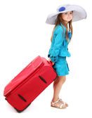 Portrait of little girl with travel case and hat isolated on white — Stock Photo