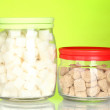 ������, ������: Jars with brown cane sugar lump and white lump sugar on colorful background