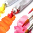 Abstract acrylic paint, paint tubes and brushes isolated on white — Stock Photo