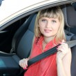 Royalty-Free Stock Photo: Happy smiling blonde woman in car