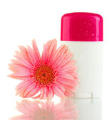 Deodorant with flower isolated on white — Stock Photo