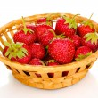 Stock Photo: Sweet ripe strawberries in basket isolated on white