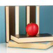 Blue and black books with apple  isolated on white — Stock Photo