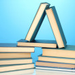 Pile of books on blue background — Stock Photo