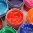 Jars with multicolored gouache on white background close-up — Stok fotoğraf