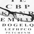 Eyesight test chart with glasses close-up — Stock Photo #11483932