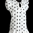 Woman white black polka dot dress on mannequin on black background — Stock Photo