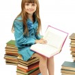 Little girl with a books isolated on white — Stock Photo