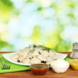 Stock Photo: Delicious cooked dumplings in the dish on bright green background