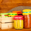 Jars with canned vegetables on wooden background close-up — Stock Photo #11484521