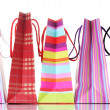 Bright shopping bags isolated on white -  